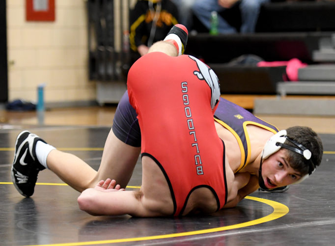 Webster City sophomore 138-pounder Cade Felts (facing) rolls up Algona's Donovan Berte for a first-period fall last night in Iowa Falls. Felts collected a pair of pins in under one minute and the Lynx blitzed Algona and Iowa Falls-Alden in a North Central Conference triangular. The Lynx topped Algona, 51-21, and then steamrolled the Cadets, 50-30. DFJphoto/Troy Banning