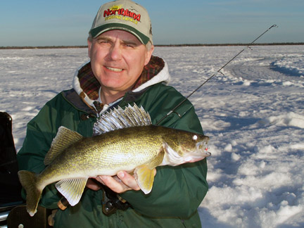 John Peterson caught this nice walleye in stained water on a rattling spoon.