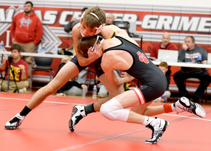 WCHS 106-pounder Trey Nelson (facing) battles Andrew Flora of ADM during the semifinal round of the DC-G Mustang Invitational in Grimes on Saturday. DFJ photo/Troy Banning