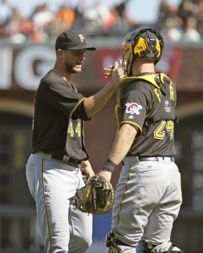 Pittsburgh Pirates relief pitcher Tony Watson, left, is greeted by catcher Eric Fryer at the end of a baseball game against the San Francisco Giants on Wednesday, Aug. 17, 2016, in San Francisco. Pittsburgh won 6-5. (AP Photo/Eric Risberg)