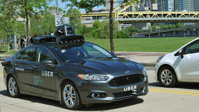 NEED A RIDE? — In this undated file photo provided by Uber, a Ford Fusion hybrid outfitted with radars, laser scanners and high-resolution cameras drives along the streets of Pittsburgh. Uber said Thursday that passengers in Pittsburgh will be able to summon rides in self-driving cars with the touch of a smartphone button in the next several weeks. The high-tech ride-hailing company said that an unspecified number of autonomous Ford Fusions with human backup drivers will pick up passengers just like normal Uber vehicles. Riders will be able to opt in if they want a self-driving car, and rides will be free to those willing to do it, spokesman Matt Kallman said.