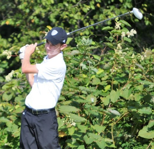 Mike Mathison ON THE TEE — Harrison Central's Clint Heavilin hits a tee shot on the par 5 third hole during Monday's match with Harrison Central at Mountaineer Woodview Golf Course. Heavilin was the medalist with a 38.