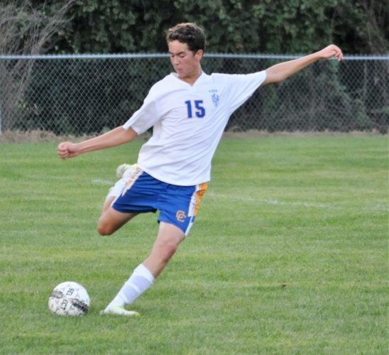 Mike Mathison THURSDAY SOCCER — Steubenville Catholic Central junior Mark Kissinger looks to clear the ball during the second half of Thursday's 1-0 over Weir High.