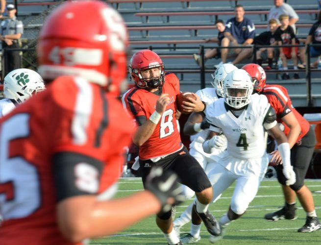 Matthew Peaslee OPENING THE SEASON — Steubenville quarterback Johnny Agresta runs for a 32-yard touchdown during the second quarter of Thursday's 49-33 opener against D.C. Woodrow Wilson at Harding Stadium.