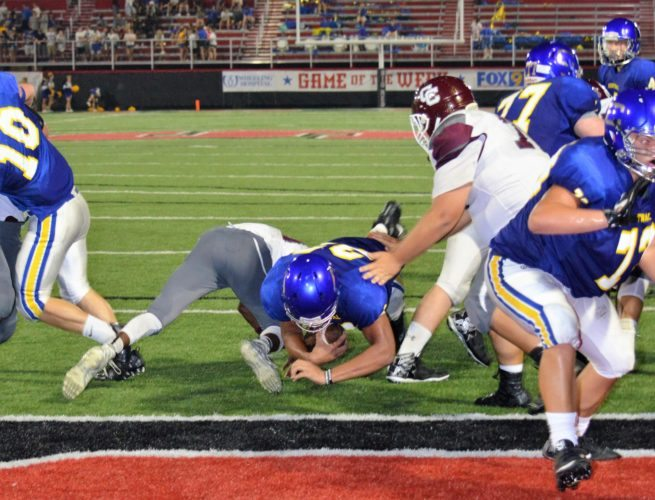 Mike Mathison OPENING THE SEASON — Steubenville Catholic Central running back Levi Thompson scored the Crusaders' only touchdown in the third quarter of Thursday's season-opening 33-6 loss to Wheeling Central at Harding Stadium.