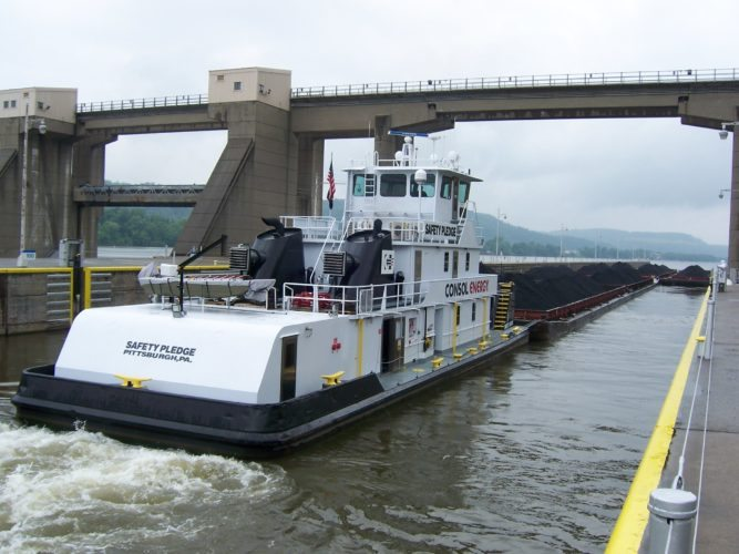 PASSING THROUGH — A Consol Energy towboat carries coal through the Pike Island Locks and Dam on the West Virginia side of the Ohio River. - Contributed