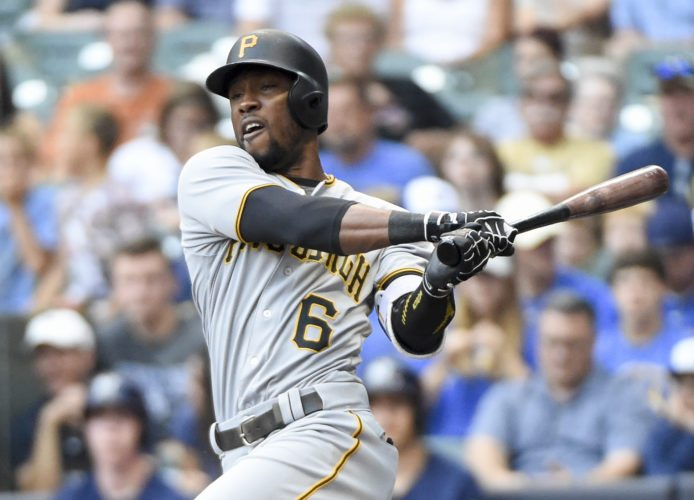 Pittsburgh Pirates' Starling Marte follows through on an RBI double during the first inning of a baseball game against the Milwaukee Brewers on Saturday, Aug. 27, 2016, in Milwaukee. (AP Photo/Benny Sieu)