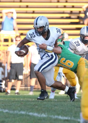 POSTIVEYARDS — Madonna's Donavan Kirby, who rushed for three touchdowns, gains positive yards in Saturday's 29-27 loss to Bishop Donahue. (Alex Kozlowski)
