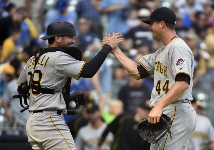Pittsburgh Pirates pitcher Tony Watson, right, celebrates with catcher Francisco Cervelli, left, after they defeated the Milwaukee Brewers in a baseball game Sunday, Aug. 28, 2016, in Milwaukee. (AP Photo/Benny Sieu)