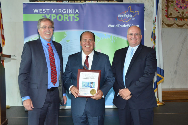 Eagle Manufacturing Co. of Wellsburg was presented four commendations from Gov. Earl Ray Tomblin for its contribution to the expansion of U.S. exports. With Tomblin, center, are Mike Oliu, left, international sales manager for Eagle; and Steve Roberts, business development manager for Eagle. — Contributed