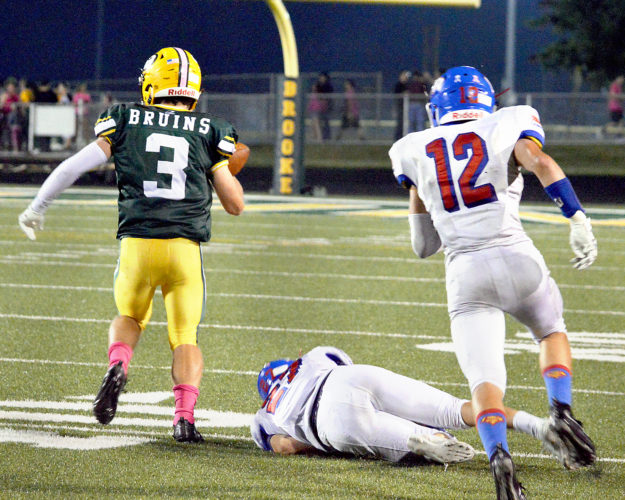 PAYDIRT — Brooke's Chris Yachini gets away from Wheeling Park defenders to score on a 75-yard touchdown pass from quarterback Logan WIlliams Friday night in Wellsburg. (Michael D. McElwain)