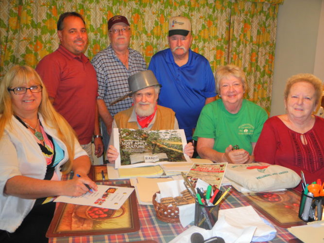 APPLEFEST TO RETURN — Gathered to finalize plans for the 38th-annual Wellsburg Applefest were, front, from left, Robin Snyder; Michael O'Brien, who co-chairs the event with Ernie Jack; Rita Ramsey, associate chair; and Mary Ann Sayre: and back, Frank Johnson; Jerry Fluharty; and Greg Cheeks. The committee also includes Shirlie Rogers, Carol Lynn, George DeGarmo and Alex Weld. The festival will be held Oct. 7-9 on Charles Street and the Wellsburg Town Square. - Warren Scott