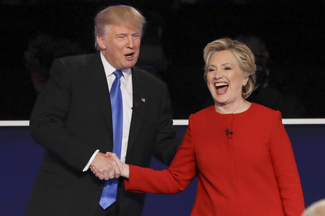 Republican presidential nominee Donald Trump and Democratic presidential nominee Hillary Clinton shake hands after the presidential debate at Hofstra University in Hempstead, N.Y., Monday - Associated Press