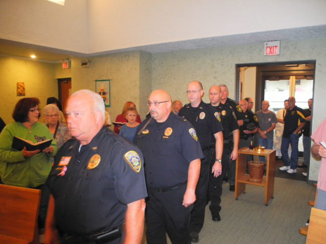 Members of local law enforcement and fire departments were asked to be a part of the procession for a Blue Mass celebrated at St. Anthony Catholic Church in Follansbee Thursday. — Warren Scott