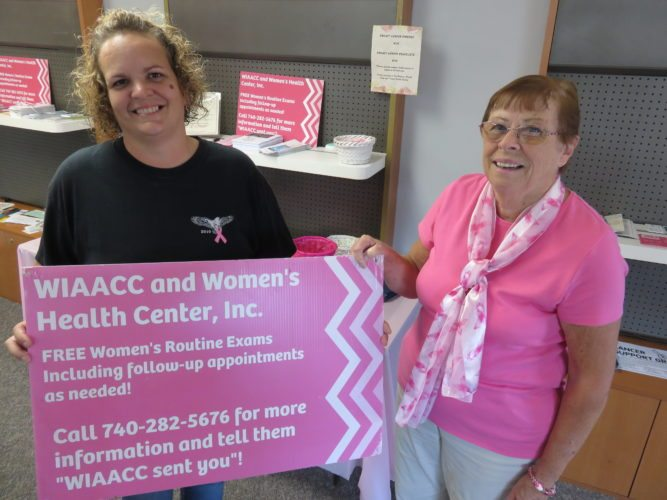READY FOR EVENT — Leslie Aftanas, left, co-chair of the Women in Action Against Cancer Coalition, and Janet Pillar, corresponding secretary, are helping with tonight's Breast Cancer Awareness Wreath Ceremony. -- Janice Kiaski