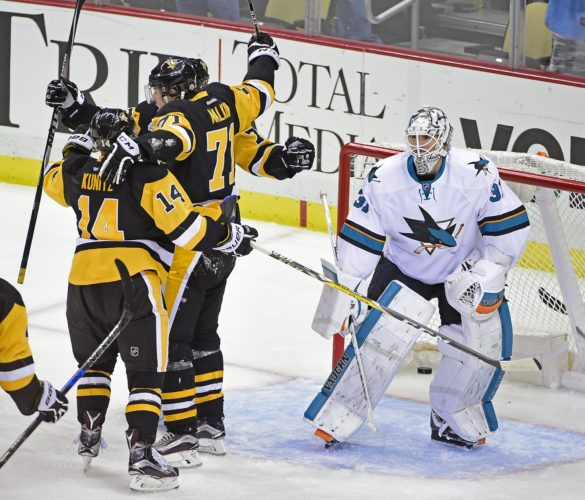 Pittsburgh Penguins left wing Chris Kunitz (14), center Evgeni Malkin (71) and Pittsburgh Penguins right wing Patric Hornqvist (72) celebrate the winning goal in front of San Jose Sharks goalie Martin Jones (31) during the third period of an NHL hockey game on Thursday, Oct. 20, 2016, in Pittsburgh. The Penguins defeated the Sharks 3-2. (AP Photo/Fred Vuich)