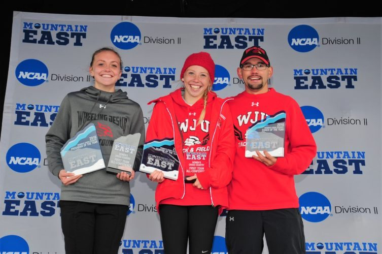 HONORED — The Wheeling Jesuit women's cross country team won the MEC championship Saturday. Oak Glen graduate Kelsey Chambers (middle) was named the Runner of the Year after winning the individual title. Teammate Lindsay Scheffel was named Rookie of Year and Ryan Moore Coach of the Year. (Courtesy Wheeling Jesuit Athletic Department)