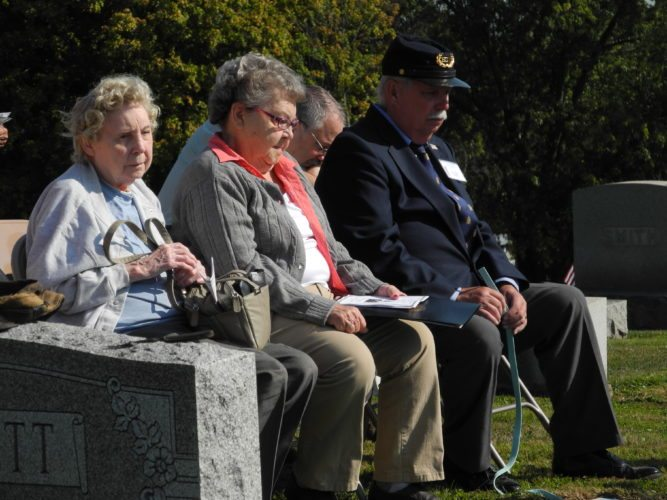 Leah Hall, 91, of Columbus, and Yvonne Busby, 86, of Brushy Fork in Harrison County, daughters of Marion B. Barrett, Civil War soldier, and David Rose, who assisted with the presentation, listened to the speakers taking part in the Last Soldier Ceremony held recently at Union Cemetery in Cadiz. — Esther McCoy