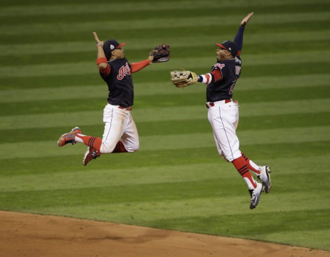 Cleveland Indians' Francisco Lindor and Rajai Davis celebrate after Game 1 of the Major League Baseball World Series against the Chicago Cubs Tuesday, Oct. 25, 2016, in Cleveland. The Indians won 6-0 to take a 1-0 lead in the series.(AP Photo/Gene J. Puskar)