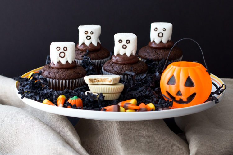 'FRIGHTENING' FOOD — This is the time for Halloween parties with a hint of fright in the food served. Here are some ghostly looking characters made with marshmallows and chocolate frosting, doing their haunting on top of moist, homemade chocolate cupcakes. Chocolate is a big favorite for Halloween — think about all the chocolate bars that will be gathered into the trick or treat bags and probably be sampled on the way home, so these cupcakes will be tempting. -- Contributed