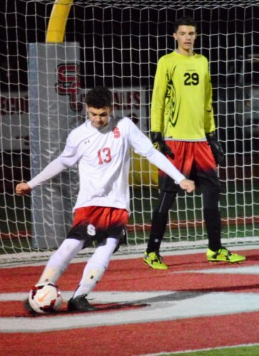 Mike Mathison GOAL KICK — Steubenville senior Ethan Brown takes a goal kick in front of keeper jacob Clevenger during Wednesday's 2-0 victory over Maysville in the Division II Eastern District semifinals.