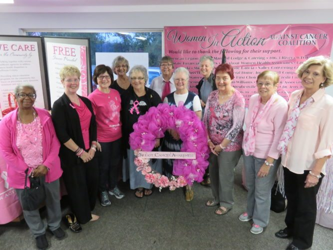 Among breast cancer survivors who were acknowledged during the Women In Action Against Cancer Coalition's 20th-annual Ohio Mammography Day Wreath Ceremony held Oct. 19 at the Kay Corabi Community Room in Steubenville were, front, from left, Joyce Summers, survivor story speaker Tammy Smedley, Susan Arlotta, Kelli Knight, Becky McMasters, Carolyn McCamic, Janet Pillar and Jean Hanlin, and back, Joanne Pederson, Marlene Lesnansky, who presented them with special bracelets, and Ann Craig.  -- Janice Kiaski