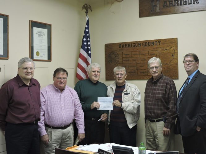 RECEIVE CHECK — Harrsion County commissioners met with representatives from Shell Pipeline and Harry Horstman, the Conotton Trail Committee chairman, during Wednesday's meeting. Commissioners accepted a check for $9,600 from Shell Pipeline for the rights to bore a pipeline beneath the trail. On hand were, from left, Paul Kelley, Bill Thompson, Horstman and Commissioners Bill Host, Dale Norris and Don Bethel. -- Dylan McKenzie