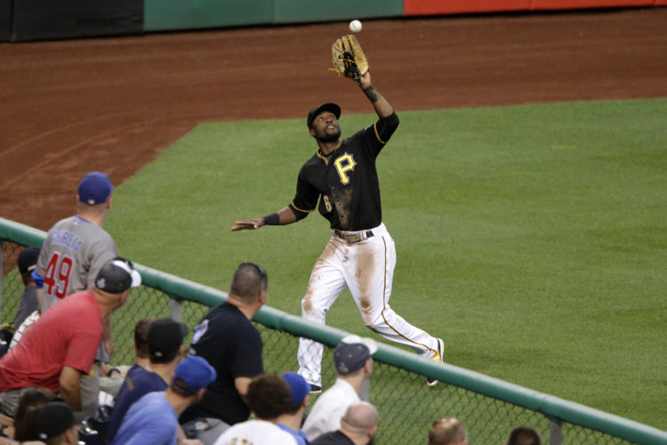 Pittsburgh Pirates left fielder Starling Marte makes the catch on a fly ball by Chicago Cubs' Anthony Rizzo in the fourth inning of a baseball game in Pittsburgh, Friday, July 8, 2016. (AP Photo/Gene J. Puskar)
