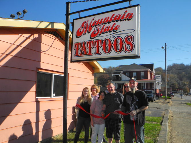 NEW TATTOO PARLOR — Mike Viderman, owner of Mountain State Tattoos, and his staff marked the opening of the new business at 67 12th St., Wellsburg, with a ribbon cutting conducted by the Wellsburg Chamber of Commerce. Participating were, front, from left, tattoo artist Kayla Haddon, Heather Viderman, Mike's wife; Mike Viderman, and tattoo artist Jason Flenniken: and back, Jacie Ridgely, chamber executive director; and Donna Conley, chamber board member.  -- Warren Scott