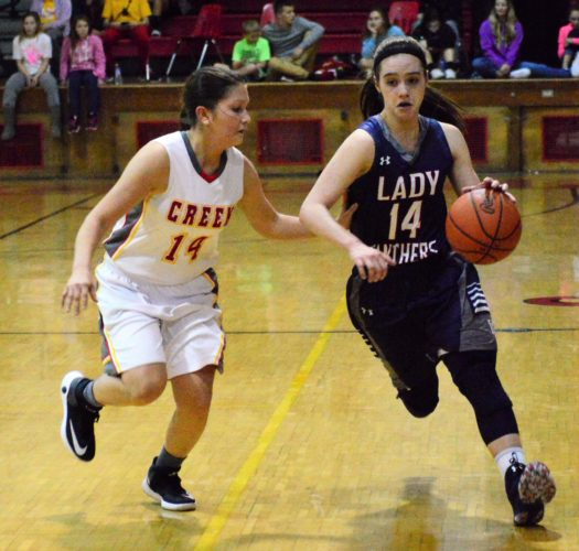 DOWN THE COURT — Buckeye Local's Emily Holzopfel dribbles against the defensive pressure of Indian Creek's Hallie Schmitt during the second half of Thursday's game in Wintersville. Holzopfel scored 29 points to lead the Panthers to a 56-44 victory. (Mike Mathison)