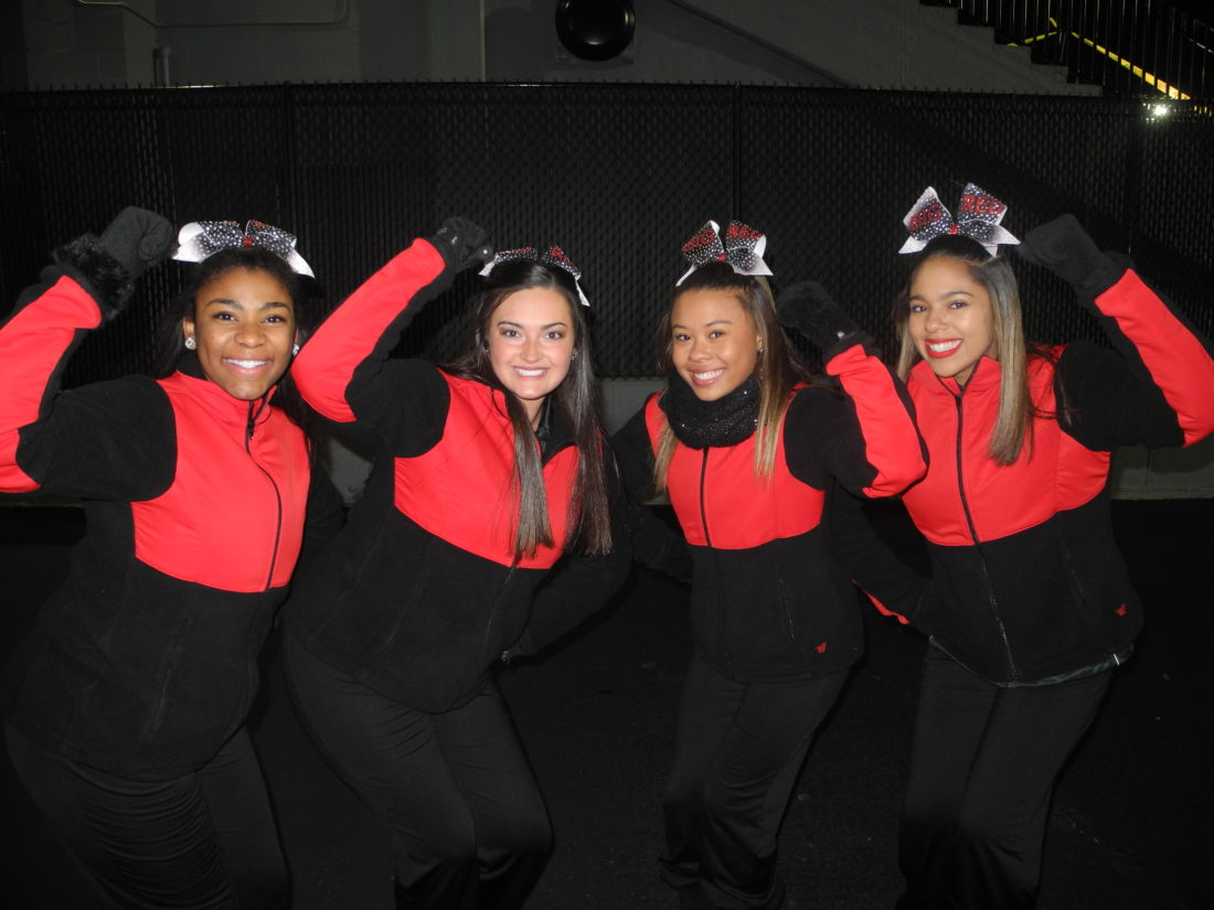 Steubenville High School cheerleaders, from left, Jaliyan Hubbard, Jessica Walkosky, Jalen Byram and Koreyn Gray were ready to rock during the pep rally held Thursday evening at Harding Stadium. The Steubenville Big Red football team will take on Columbus Bishop Hartley in the Division IV state championship game today in Columbus. Speakers, the Steubenville High School Marching Band and a packed stadium of fans were there to cheer the team on Thursday. — Mark J. Miller