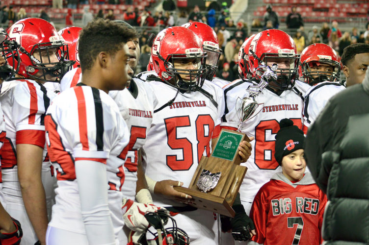 SECONDPLACE — Members of the Steubenville football team accept the second place trophy after falling to Bishop Hartley, 24-21, in the Division IVstate championship game at Ohio Stadium on the campus of Ohio State University. (Michael D. McElwain)