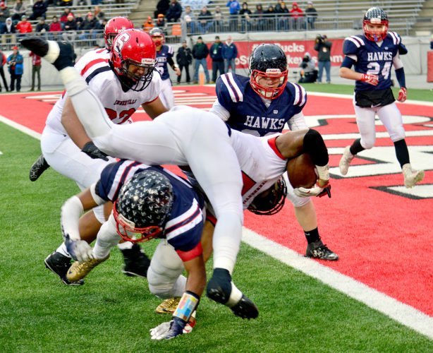 GAMEACTION — Left, Steubenville's Jalen McGhee runs for positive yards in the first half against Bishop Hartley. (MIchael D. McElwain)