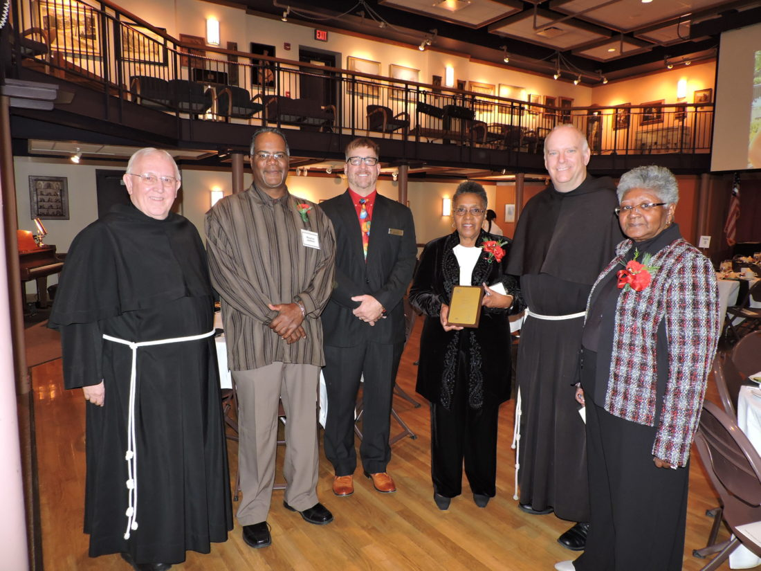 "The late Anita Jackson was honored by the Franciscan University of Steubenville during the 67th annual Founders' Association dinner Saturdaåy night. Chatting prior to the dinner were several university officials as well as members of the Jackson family including, from left, the Rev. Richard Davis, TOR,  minister provincial of the Sacred Heart Province, based in Loretto, Pa.; Maurice Jackson; Michael Florak, executive director of the Franciscan University Office of Community Relations; Helen ""Wendy"" Jackson; the Rev. Sean O. Sheridan, president of Franciscan University of Steubenville and Portia Jackson. — Dave Gossett"