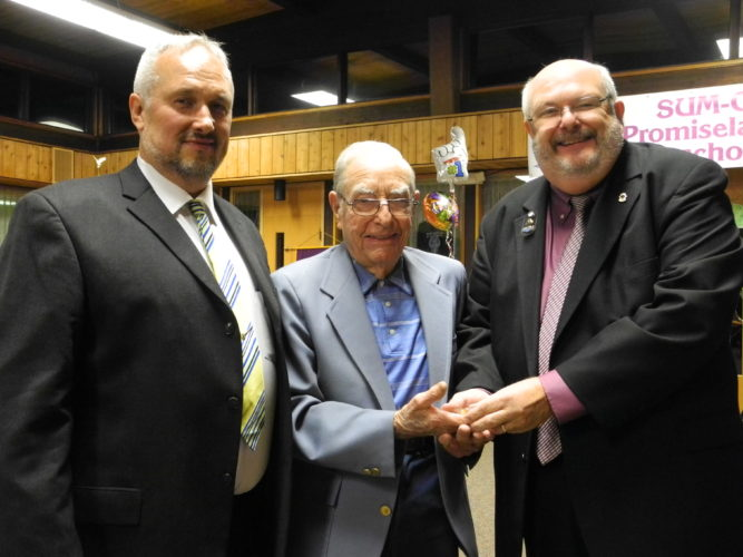 HONORED — John Tabacci, center, received a Lifetime of Lionism award for his 70-year membership in the Cadiz Lions Club. At 99, he has been an active and integral part of the club, serving in office at the local, zone, district and state levels. Dale Davis, club president, left, and Rob Murry, past district governor, presented awards to Tabacchi, a World War II veteran who told tales of those years. Bill Sanders was presented with the same award in addition to one for receiving the Purple Heart for injuries sustained in World War II battle.  -- Esther McCoy