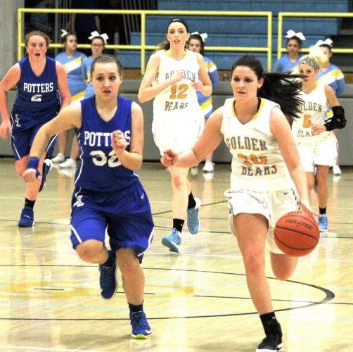 Joe Catullo      TO THE BASKET — Oak Glen's Maisie Witherow (10) dribbles the ball past East Liverpool's Kenzie McKinnon (32) during Wednesday's 59-52 Golden Bears home win. Also shown are East Liverpool's Emma Ludwig (2) and Oak Glen's Amber Grotefend (12) and Maggie Kovalcik (5).