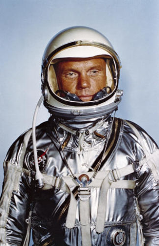 This undated photo made available by NASA shows astronaut John Glenn in his Mercury flight suit. Glenn, the first American to orbit Earth who later spent 24 years representing Ohio in the Senate, died Thursday, Dec. 8, 2016, at the age of 95. (NASA via AP)