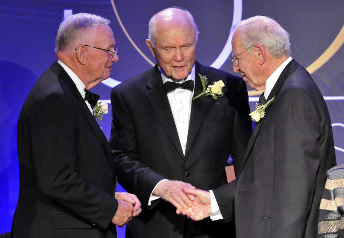 Astronauts Neil Armstrong, left, the first man to walk on the Moon, John Glenn Jr., center, the first American to orbit Earth, and James Lovell, right, commander of Apollo 13, stand in 2008 at a gathering of 19 of the astronauts who call Ohio home in Cleveland. The gathering of Ohio astronauts was part of NASA's 50th Anniversary celebration. Glenn died Thursday at the age of 95. — Associated Press