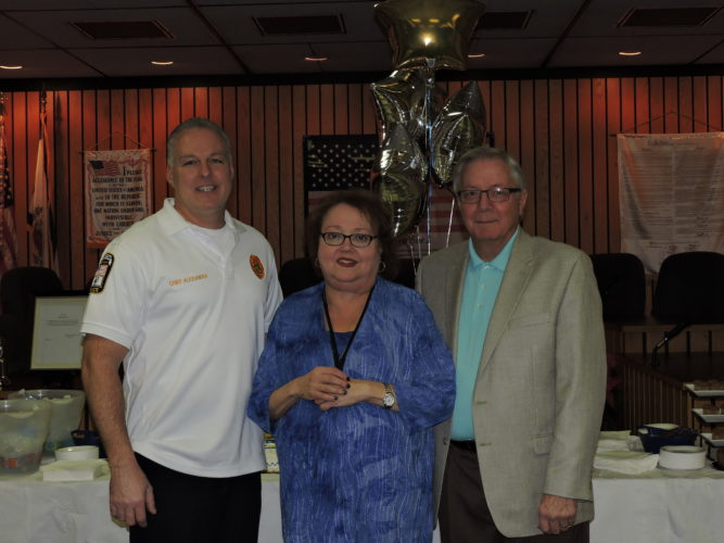 l50 YEARS OF SERVICE — The City of Weirton on Thursday celebrated the retirement of Bertha Simich, after 50 years of service to the city. Standing with Simich during a reception at the Weirton City Building are Police Chief Rob Alexander, left, and Mayor Harold Miller. - Craig Howell