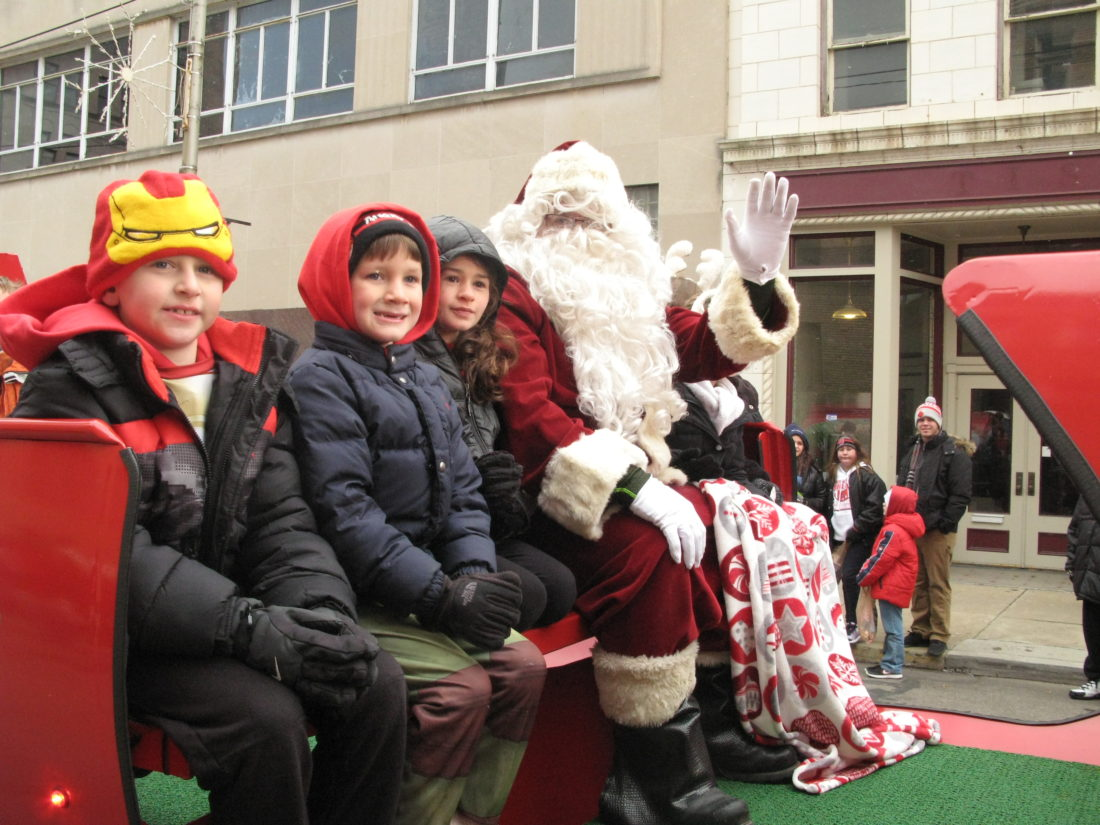 SLEIGH RIDE — The 2016 Sights and Sounds of Christmas Parade: Nutcracker Magic, sponsored by Eastern Gateway Community College, marched down Fourth Street in downtown Steubenville on Saturday. Santa made his appearance at the end of the parade, waving to all the good boys and girls. -- Mark Law