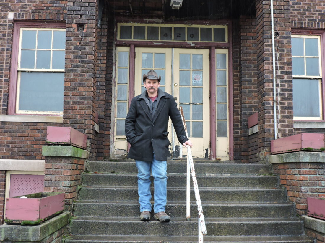 nelson purchase saves downtown building news sports jobs the local businessman mark nelson stands on the steps of a washington street building he recently purchased