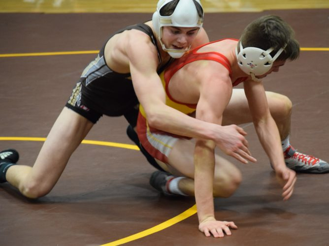 DUALTIME — John Marshall's Jordan Wood and Indian Creek's Michael Grimm wrestle at 120 pounds in Wednesday's OVACDual Meet at John Marshall High School. (Seth Staskey)