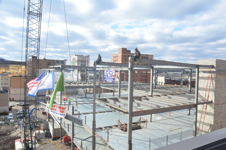 Contractors working on the Health Plan's new headquarters in downtown Wheeling placed the final beam of the structure's steel frame Monday. — Scott McCloskey