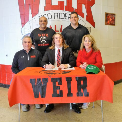 HEADED TO MARSHALL — Weir High senior Domenick Murphy, flanked by his parents Richard Murphy and Monica Tonacchio, will continue his academic and athletic careers at Marshall University, where he will major in exercise physiology and be a preferred walk-on member of the football program. Also on hand for the signing were, from left, head coach Tony Filberto, Physical Therapist John Kirlangitis. (Mike Mathison)