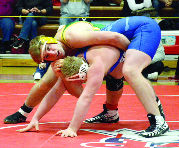 Kim North WINNING ANOTHER TITLE — Brooke senior Alex Edgell battles Cameron Payne of Buckhannon-Upshur in the 220-pound final at the West Virginia Class AAARegion 1 championships Saturday evening at Wheeling Park. Edgell won, 3-1. He is 35-3 on the season.