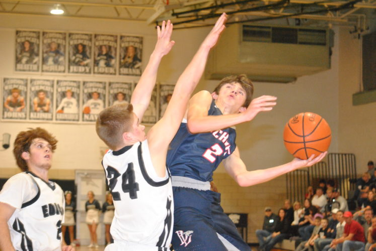 TAKINGITTOTHEHOOP — Buckeye Local's Drake Novak attempts a lay up against the defense of Edison's Alec McBane as Bryce Piatt of the Wildcats looks on. The Panthers beat the Wildcats, 78-68, in the OVAC4A consolation final.  (Matthew Peaslee)