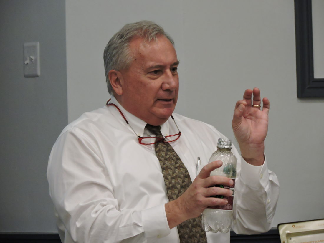 Don Ogden, director of behavioral health at Trinity Health System, showed a group of area educators how a plastic pop bottle can be used to smoke marijuana. Ogden spoke at the first session of the Trinity's Working Together for the Health of Our Communities program held Tuesday afternoon. — Dave Gossett