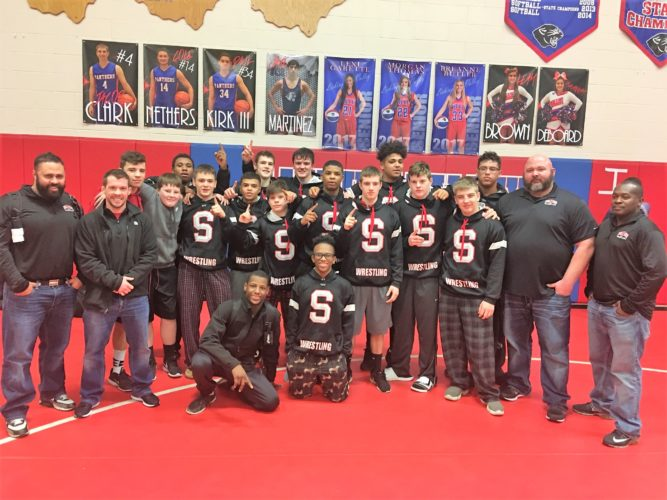 SECTIONAL CHAMPS — Members of the Steubenville wrestling team pose in Newark on Saturday. (Contributed)
