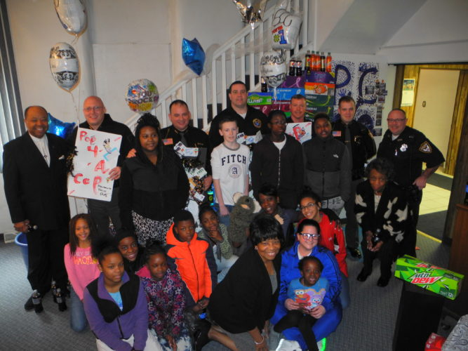 Warren Scott SHOWING APPRECIATION — Members of Greater Zion Temple Family Worship Center, including many youth, presented soft drinks and gift cards to local restaurants to members of the Steubenville Police and Jefferson County Sheriff's departments to show their appreciation for their protection of the community. -- Warren Scott