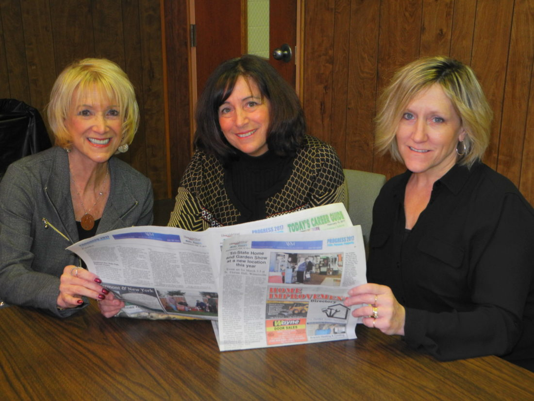 More than 50 area businesses are slated to participate in the Tri-State Home & Garden Show Friday through Sunday at St. Florian Hall in Wintersville. Reading recent coverage of the event in the Herald-Star and Weirton Daily Times are, from left, Brenda Mull of the Weirton Area Chamber of Commerce, Lisa Conti of Weirton Medical Center and Tricia Maple-Damewood of the Jefferson County Chamber of Commerce. — Warren Scott